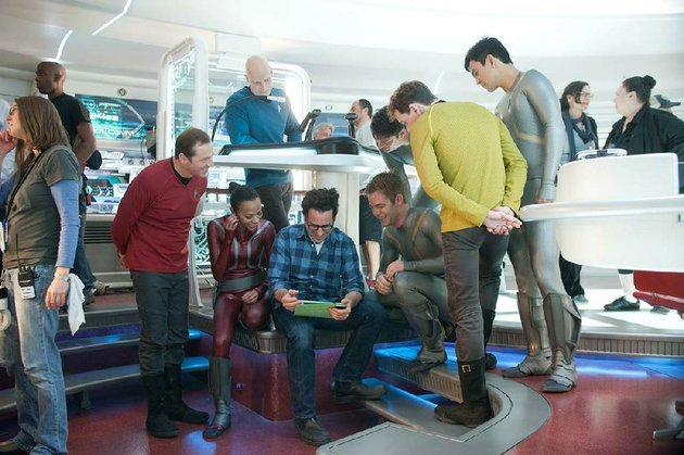 writer-director-jj-abrams-seated-with-ipad-is-surrounded-by-the-crew-of-the-starship-enterprise-on-the-set-of-star-trek-into-darkness