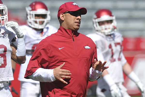 Arkansas Assistant/Wide Receivers Coach coach Michael Smith works with his team during practice Saturday morning at Razorback Stadium in Fayetteville.