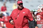 Arkansas coach Bret Bielema watches the Razorbacks warm up during practice April 6, 2013 at Razorback Stadium in Fayetteville.