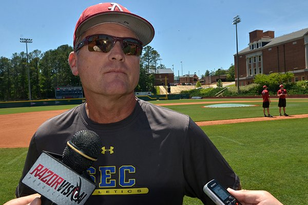 Arkansas coach Dave Van Horn speaks with reporters Friday afternoon after the Razorbacks' practice at Samford University in Birmingham, Ala.