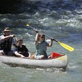 Paul, Shad and Sarah Gibson, all of Carbondale, Ill., make their way into the Buffalo National River...