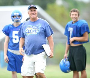 Decatur football coach Shane Holland works with his team last summer in Decatur.