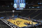 Arkansas players practice at Bridgestone Arena in Nashville, Tenn. prior to the 2013 SEC Basketball Tournament.
