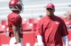 Arkansas assistant coach Michael Smith works running back Nate Holmes during practice April 6, 2013 at Razorback Stadium in Fayetteville.