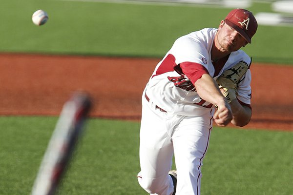 Arkansas pitcher Barrett Astin, top, throws to a Bryant batter Kevin Brown in the first inning during an NCAA college regional baseball game in Manhattan, Kan., Friday, May 31, 2013. (AP Photo/Jeff Tuttle)