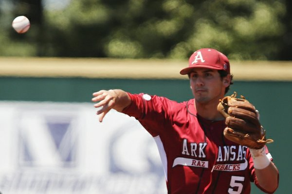 Arkansas infielder Brett McAfee throws to first base to complete a double play after forcing out a runner at second in a NCAA baseball regional game in Manhattan, Kan. The Razorbacks turned four double plays in the 12-3 win over the Bulldogs. (AP Photo/Jeff Tuttle)