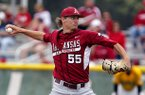 Arkansas starting pitcher Ryne Stanek delivers to a Wichita State batter in the first inning of an NCAA baseball regional game in Manhattan, Kan., Saturday, June 1, 2013. (AP Photo/Jeff Tuttle)