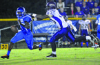 Junction City's Jamario Bell catches Strong quarterback Jacoby Heard for a big loss during the first quarter of a Sept. 21, 2012 game at Strong.