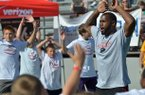 Oakland Raiders and former Razorback running back Darren McFadden leads the warm ups with the kids at the start of the Darren McFadden Football ProCamp at Jarrell Williams Bulldog Stadium in Springdale Friday morning.