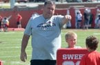 Arkansas offensive line coach Sam Pittman helps kids work on their blocking skills during the University of Arkansas Youth Football Camp at the University of Arkansas.