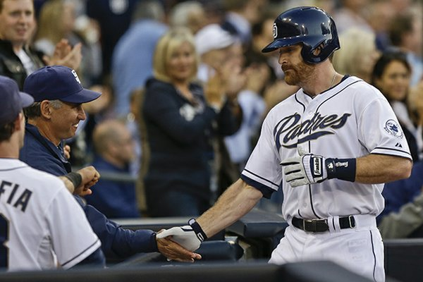 San Diego Padres' Logan Forsythe , right, is congratulated by manager Bud Black afire his solo home ragainst the Atlanta Braves in the second inning of a baseball game in San Diego, Monday, June 10, 2013. It was Forsythe's first at-bat of the season. (AP Photo/Lenny Ignelzi)