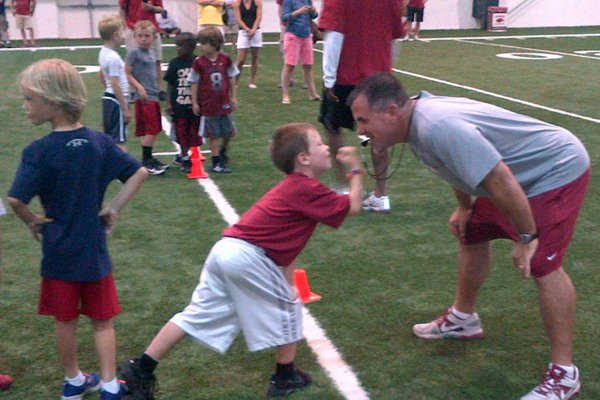 Arkansas defensive line coach Charlie Partridge, seen here at the Youth Camp in June, is a key reason why defensive end Kevin Bronson plans to make an official visit Fayetteville.