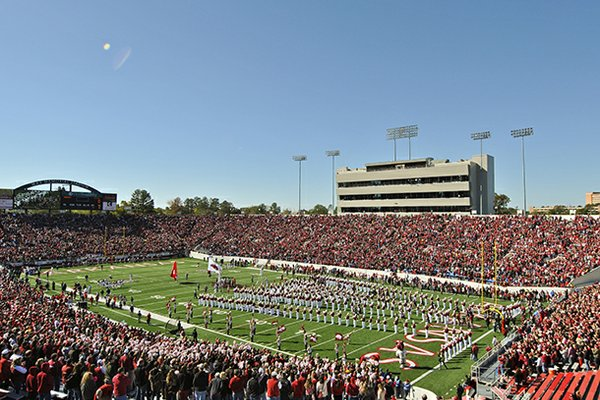 The Arkansas Razorbacks take the field before playing Ole Miss at War Memorial Stadium in Little Rock.