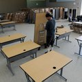 Kyle Lee, with Moser Corporation, moves a table Tuesday, June 11, 2013 to a classroom at Janie Darr ...