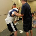 Magician Marty Boone watches Matthew Furnish, left, get turned into a mummy with tissue paper by Hav...