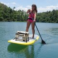 Debbi Neece enjoys a warm afternoon on June 7 at Beaver Lake on her stand-up paddle board. Paddle bo...