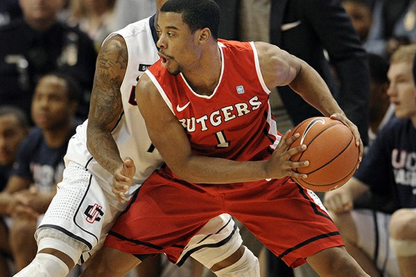 FILE - In this Jan. 27, 2013 file photo, Rutgers' Jerome Seagears, front, is guarded by Connecticut's Ryan Boatright during the second half of an NCAA college basketball game in Hartford, Conn. Former Rutgers basketball player Seagears has changed his mind about transferring to Auburn. Auburn coach Tony Barbee said in a statement Monday, June 10, 2013, that Seagears told the coaches that he wanted to be closer to his family in Silver Springs, Md. (AP Photo/Jessica Hill, File)