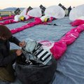 In this June 10, 2013 photo released by Google, Jordan Miceli prepares electronics to launch balloon...