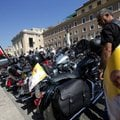Harley Davidson motorcycles riders park their motorcycles in Via della Conciliazione leading to the ...
