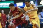 Keaton Miles, right, fouls Iowa State's Will Clyburn in the second half of an NCAA college basketball game at WVU Coliseum in Morgantown, W.Va., Saturday, March 9, 2013. Miles transferred to Arkansas and will officially begin class July 1. (AP Photo/David Smith)