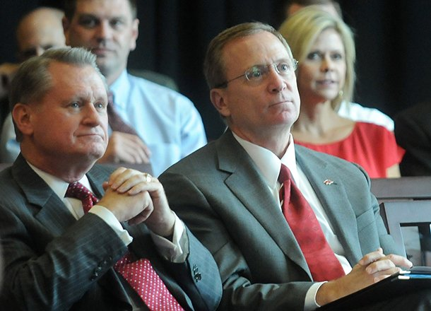 university-of-arkansas-chancellor-david-gearhart-left-and-athletics-director-jeff-long-listen-during-a-sept-14-2012-presentation-in-fayetteville