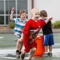 Grayson Davis, from left, 5, Joseph Johnson, 5, and Tristen Nix, 3, play with water-soaked sponges M...