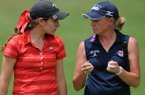 Gaby Lopez, left, takes advice from Stacy Lewis Tuesday, June 18, 2013, at Pinnacle County Club in Rogers while playing the back nine holes together for practice as part of the Ladies Professional Golf Association's Walmart NW Arkansas Championship. Tournament play begins Friday.
