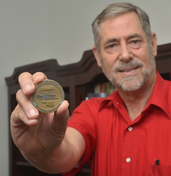 Weaver shows a commemorative coin ...