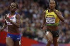 Jamaica's Veronica Campbell-Brown and France's Myriam Soumare compete in a women's 200-meter heat during the athletics in the Olympic Stadium at the 2012 Summer Olympics, London, Monday, Aug. 6, 2012. (AP Photo/Anja Niedringhaus)