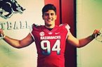 Defensive end Karl Roesler turned down scholarship offers to walk on at Arkansas.
