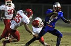 Fort Smith Northside defender Daytrieon Dean (25) attempts a tackle against Little Rock Parkview's Caelon Harden during a 2012 game.