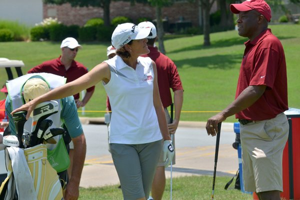 Mike Anderson, right, University of Arkansas head basketball coach, chats Thursday with pro golfer Juli Inkster before they tee off of the 11th tee during the pro-am at the Walmart NW Arkansas Championship at Pinnacle Country Club in Rogers.