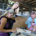 Ashley and Chris Buffer (seated) of Decatur fill out the paperwork to adopt four horses from the Fed...