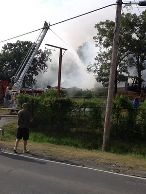 Crews respond to a blaze at a fireworks warehouse in North Little Rock Tuesday afternoon.