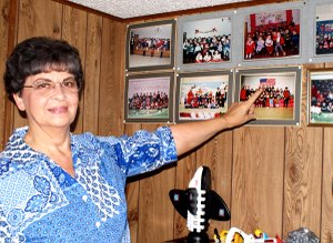 Evelyn Wilmoth points to many of the photos of children she has cared for in the past 40 years.