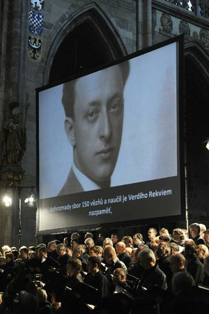 An image of Rafael Schachter is projected onto a screen during a performance of the Giuseppe Verdi's Requiem Mass at St. Vitus Cathedral in Prague, Czech Republic on Thursday, June 6, 2013. The Roman Catholic Mass was played in memory of the young musician and his fellow musicians who perished in the Terezin concentration camp, among them composers, artists and intellectuals from across Europe.