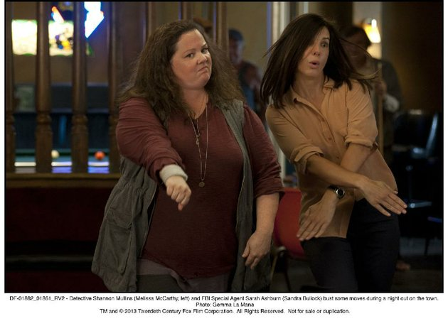 sisters-are-doing-it-for-themselves-the-unlikely-team-of-police-detective-mullins-melissa-mccarthy-and-fbi-agent-ashburn-sandra-bullock-employ-some-unusual-investigative-techniques-in-the-heat