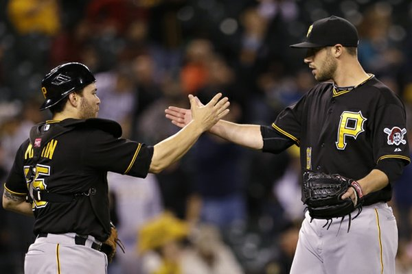 Pittsburgh Pirates catcher Russell Martin, left, and pitcher Duke Welker congratulate each other after the team beat the Seattle Mariners in a baseball game Tuesday, June 25, 2013, in Seattle. The Pirates won 9-4. (AP Photo/Elaine Thompson)
