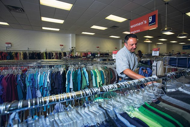 danny-gibson-of-newport-browses-through-shirts-at-the-searcy-goodwills-temporary-location-in-march-the-goodwill-stores-previous-location-burned-but-chilis-through-receipt-donations-has-contributed-to-funds-to-help-get-a-new-store-built