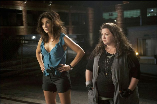 sandra-bullock-left-and-melissa-mccarthy-star-as-ill-matched-partners-fbi-special-agent-sarah-ashburn-and-boston-detective-shannon-mullins-in-the-heat-the-film-came-in-second-at-last-weekends-box-office-and-made-39-million