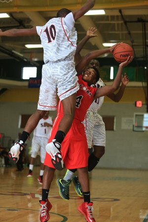 Arkansas Democrat-Gazette/RICK MCFARLAND --07/14/13--  Red Storm's Raekwon McNight, (4) is double-teamed by SBG's Delvin Benett (10) and Jalon Underwood (back) during the AAU ninth grade finals at Philander Smith College in Little Rock Sunday.