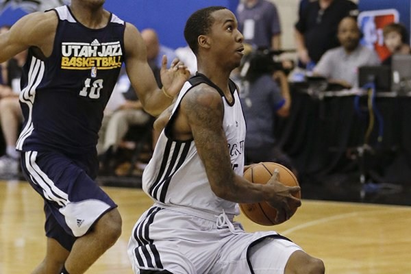 Houston Rockets' B.J. Young, right, gets out in front of Utah Jazz's Alec Burks, left, on a fast break during an NBA summer league basketball game, Tuesday, July 9, 2013, in Orlando, Fla. (AP Photo/John Raoux)