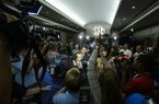 Florida Head Coach Will Muschamp moves from room to room through a throng of media during the SEC football Media Days in Hoover, Ala., Tuesday, July 16, 2013. (AP Photo/Alabama Media Group, Vasha Hunt)