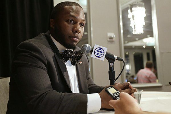 Arkansas fullback Kiero Small talks with reporters during the Southeastern Conference football media days in Hoover, Ala., Wednesday, July 17, 2013. (AP Photo/Dave Martin)