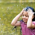 Gloria Diaz, 6, cools off in Prarie Creek on Tuesday, Aug. 2, 2011, during a late afternoon visit wi...