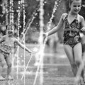 Adelyn Schaffer, 2, left, plays in a jet of water Wednesday, May 15, 2013, while enjoying an outing ...