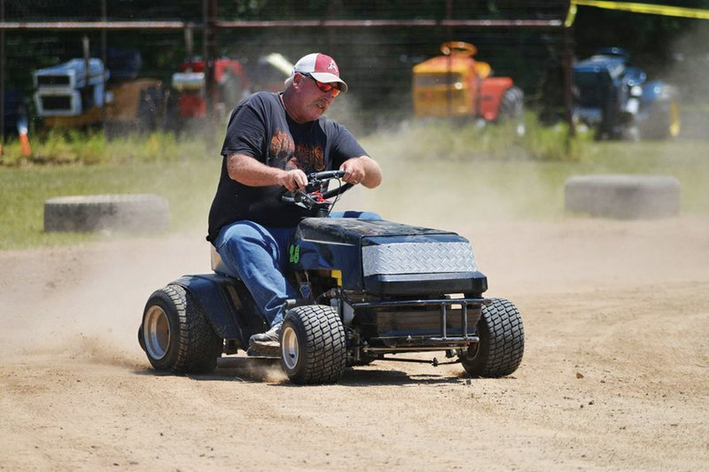 Guy mayor rides Harleys, races mowers