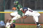 Cedar Creek's Damon Mitchell (5) carries against Willingboro during the first half Dec. 1, 2012.