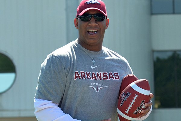 Four of Arkansas receivers coach Michael Smith's recruits from his home state committed to the Hogs in July. He uses his outgoing personality to his advantage.