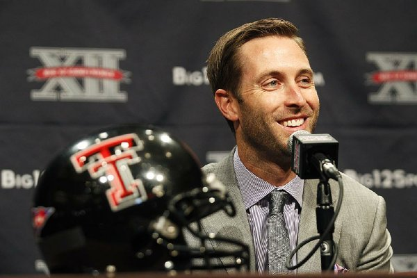 Texas Tech football coach Kliff Kingsbury addresses the media during the Big 12 Conference Football Media Days Monday, July 22, 2013 in Dallas.  (AP Photo/Tim Sharp)